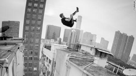 A Storror member flips between two buildings.