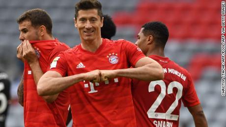 Bayern Munich striker Robert Lewandowski celebrates his first and third game for his team in Fortuna Dusseldorf's 5-0 loss.