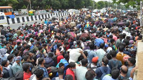 Migrant workers wait to board buses during the coronavirus blockade in Bangalore on May 23, 2020.