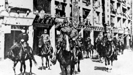 Japanese troops parade through defeated Hong Kong in 1941.
