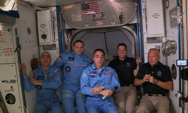 Astronauts dock at International Space Station from SpaceX craft