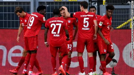 Joshua Kimmich (center) celebrates the goal against Borussia Dortmund with his teammates.