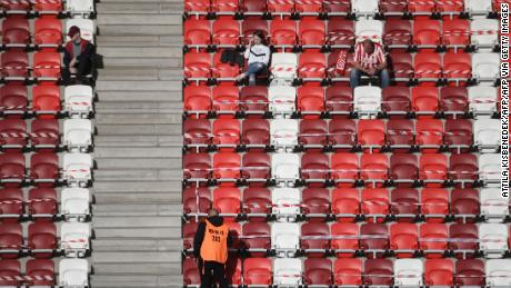 Fans of the local DVTK team wait before the start of their Hungarian league match against Mezokovesd.