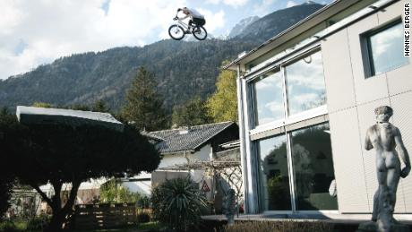 Wibmer jumps from the roof of his house into a tree.