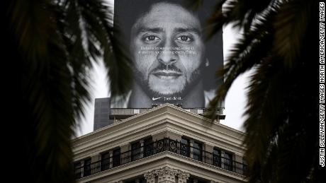 A sign with Kaepernick is displayed on the roof of the Nike store in San Francisco.