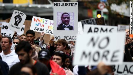 Protesters march down Queen Street in Auckland, New Zealand, on Monday.