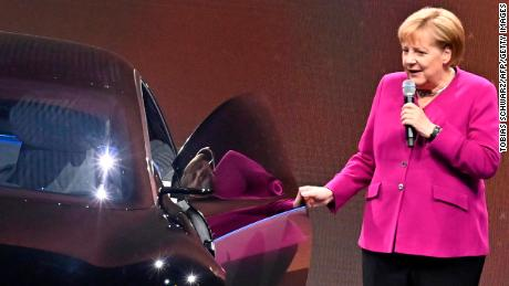 German Chancellor Angela Merkel pictured next to an electric Mercedes in 2019.