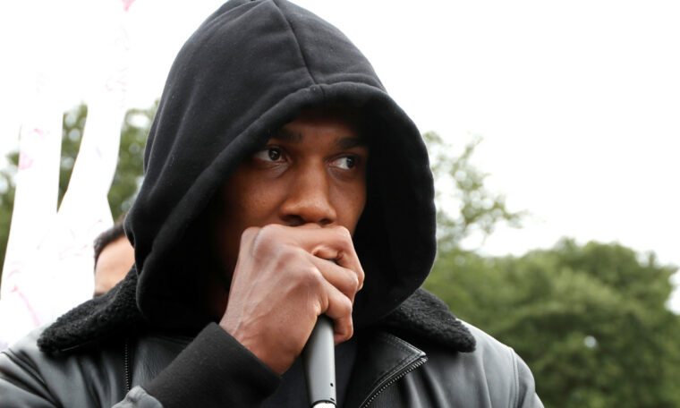 Boxing champ Anthony Joshua hits out at 'virus' of racism