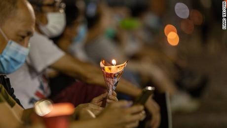 A man holds a candle at the Thursday vigil.