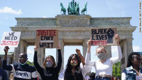 People attend a demonstration against racism in front of the Brandenburg Gate in Berlin on Sunday.