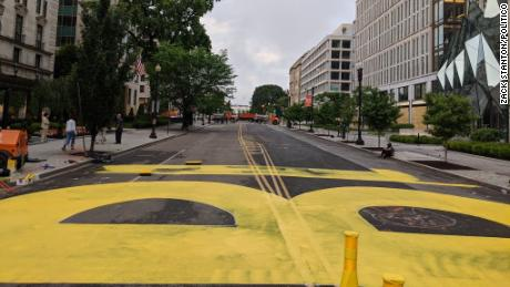 """City workers began painting """"black lives matter"""" in yellow paint on Friday on 16th Street in Washington, D.C."""