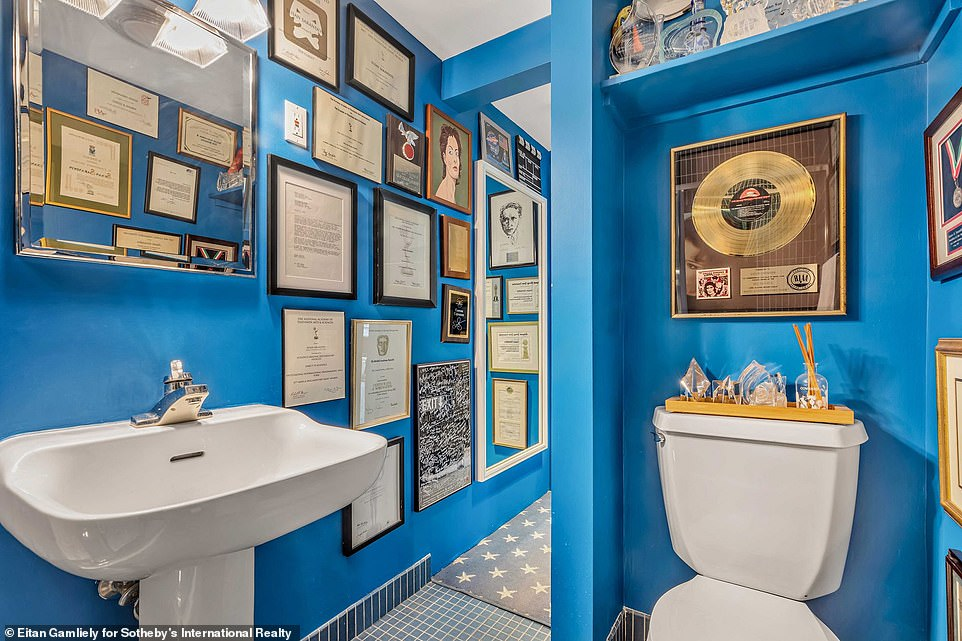 Unique: Susan styled one full bath in the loft with cobalt blue paint and calls it the Academy Award bath, according to WSJ ; the bathroom features her Oscar Award and SAG Award for Dead Man Walking, as well as her 1995 Glamour Woman of the Year Award