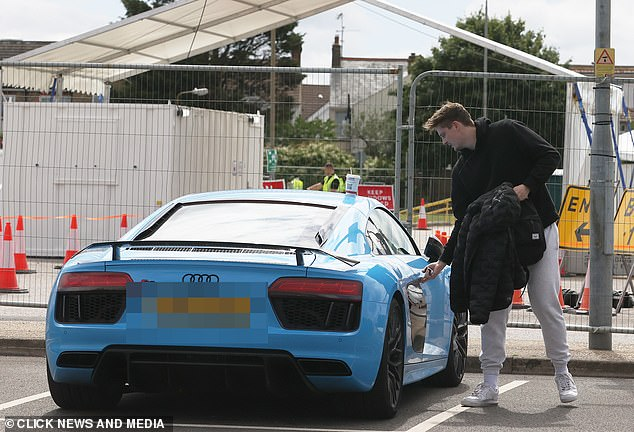 Heading home: Earlier this week, Alex was also pictured heading back to his £120,000 Audi