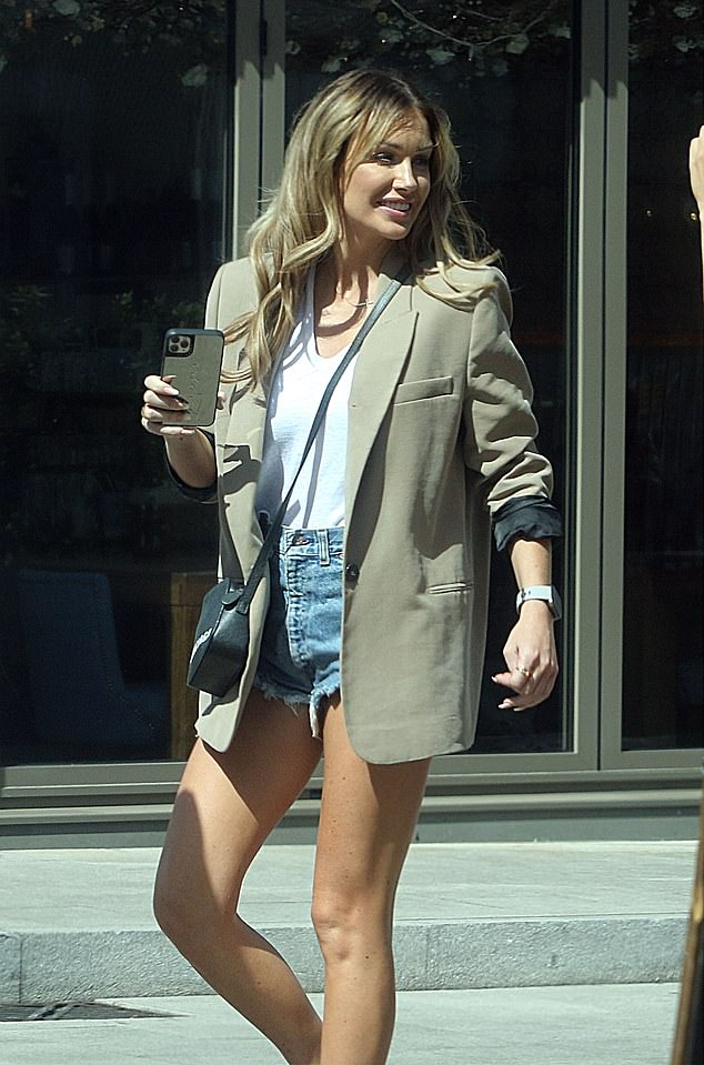 Stylish: Scottish beauty Laura cut a stylish figure for their lunch at Megan's in a beige oversized blazer
