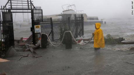 Jame Rowles examines the damage after the docks at the marina where his boat was secured were destroyed as Hurricane Hanna made landfall, Saturday, July 25, 2020, in Corpus Christi, Texas.