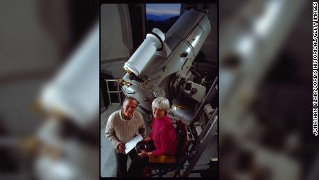 "Carolyn and Eugene Shoemaker stand by the 18"" Schmidt Telescope at the Palomar Observatory. They used it to search for asteroids and comets that may come close to the earth's orbit."