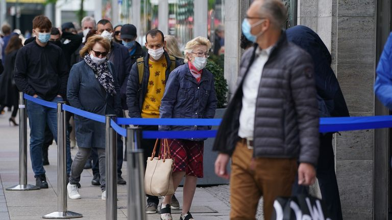 Shoppers step out in Berlin as Germany carefully lifts its lockdown