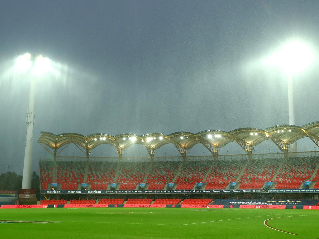 Torrrential rain hit the AFL match between the Melbourne Demons and the Brisbane Lions at Metricon Stadium on the Gold Coast, Australia. Picture: Jono Searle/AFL Photos