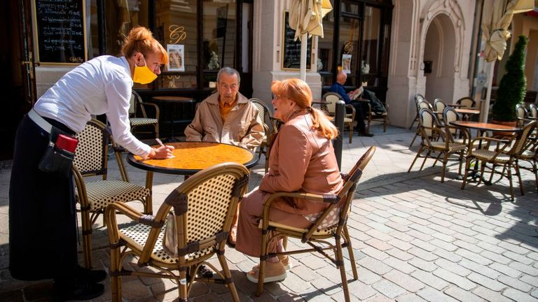 Outdoor dining at a cafe in Schwerin, northeastern Germany