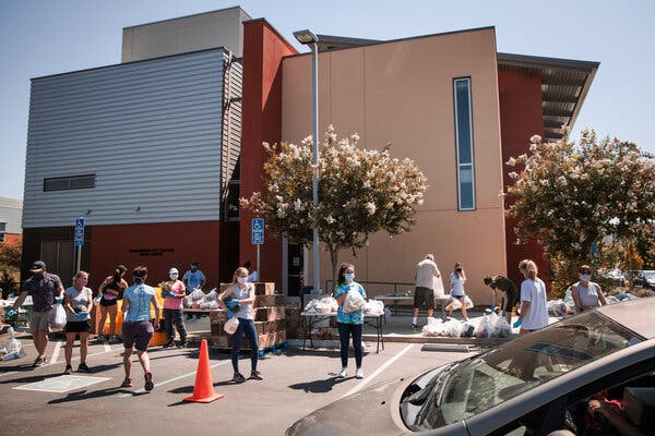 "Volunteers at a food bank in Davis, Calif., last week. ""The path forward for the economy is extraordinarily uncertain,"" the Fed chair said Wednesday."