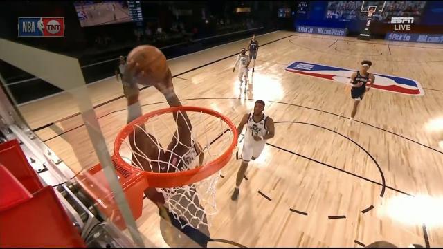 Zion slams in NBA opener