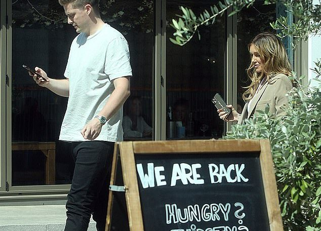 Stepping out: Love Island's Laura Anderson took a break from the social media commentary as she caught up with pal Dr Alex George for a bite to eat in Clapham on Thursday