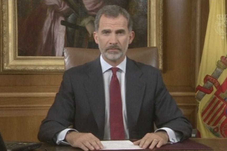 Spain's King Felipe looks at the camera as he delivers a speech in his office.