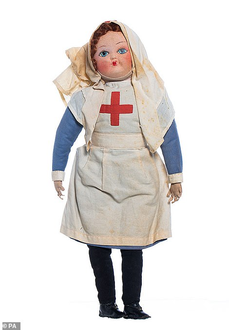 A cloth doll wearing a British Red Cross nurses uniform from the First World War, which features in the 150 Voices exhibition