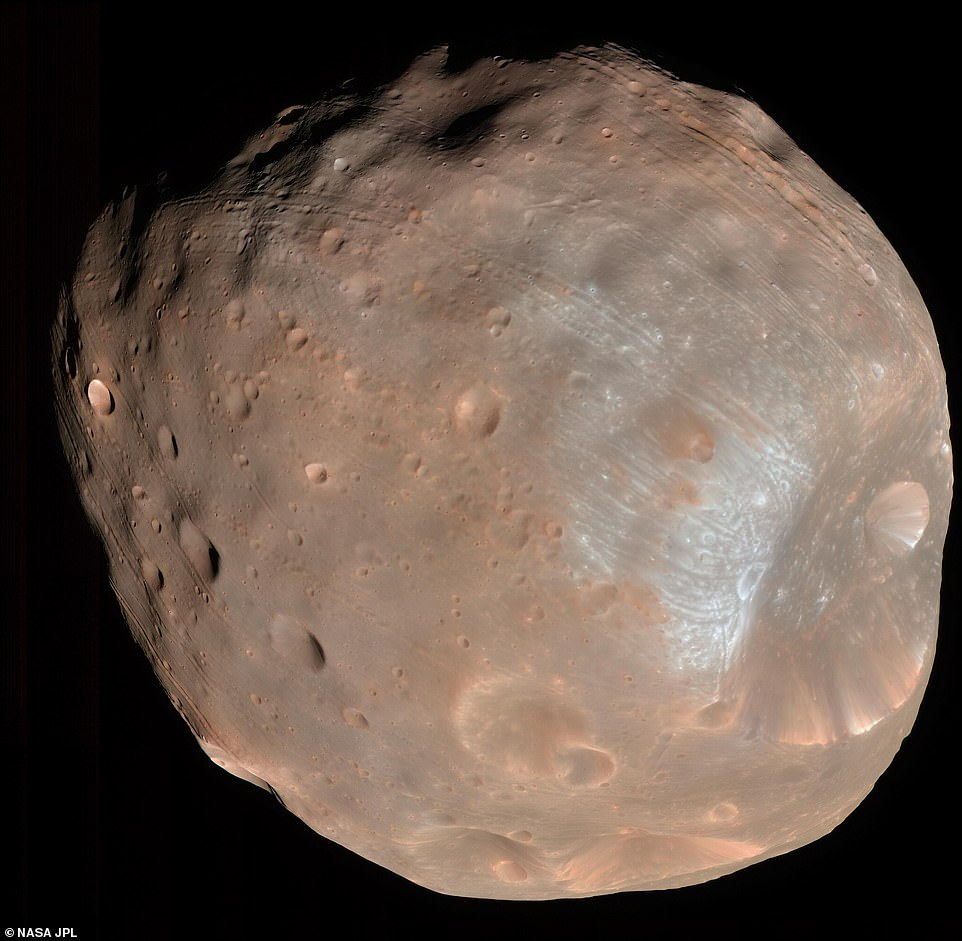 HiRISE took two images of the larger of Mars' two moons, on March 23, 2008. Called Phobos, the moon is only 13 miles across