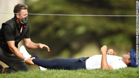 Defending champion Brooks Koepka received treatment for a sore hip during the second round at TPC Harding Park but is still within two shots of the leader after a two-under 68.