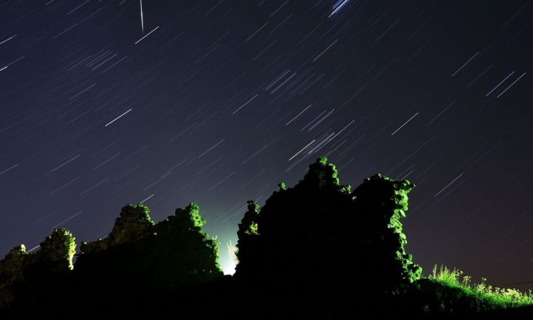 Perseid meteors seen crossing the night sky above Kreva village in Belarus on Sunday night