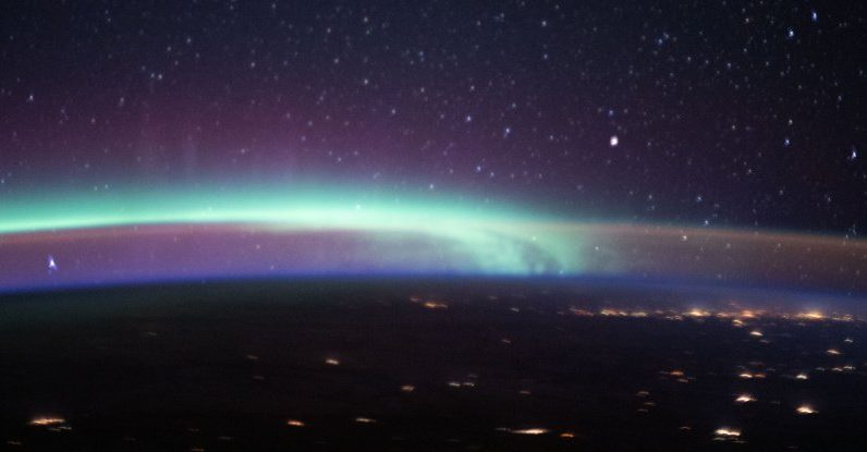 Magical Photo From The ISS Captures Two Enchanting Earth Phenomena in One Image