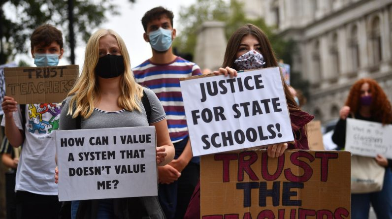 Demonstrators joining Young Socialists hold up placards outside the Department for Education, London as they protest the handling of exam results, university provision and bleak employment prospects.