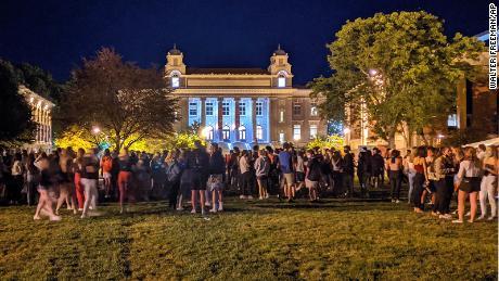 Syracuse University students gather Wednesday evening.