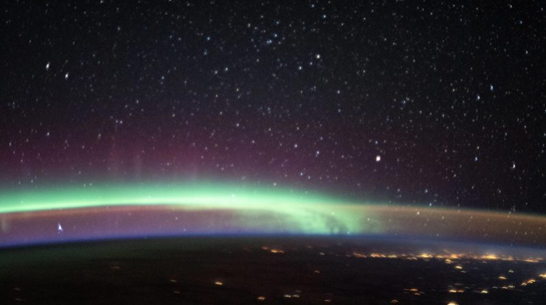 Two of Earth's Most Colorful Atmospheric Phenomena Meet in Stunning Photo From Space Station