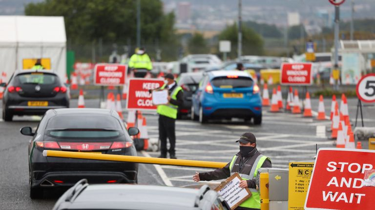 Glasgow, Scotland - August 26: An employee leads members of the public movement to a corona virus testing center at Glasgow Airport in Glasgow, Scotland on August 26, 2020 & # 8211;  Following the increase in demand for 19 test capacity in Scotland, the First Minister announced that the new mobile test units would be discontinued this weekend.  (Photo by Jeff J. Mitchell / Getty Images)