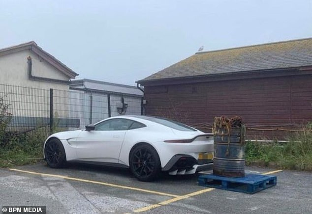 The 'ignorance' car was blocked by a barrel of chains weighing up to half a ton at the Salcomb Fish Quay in Devon.