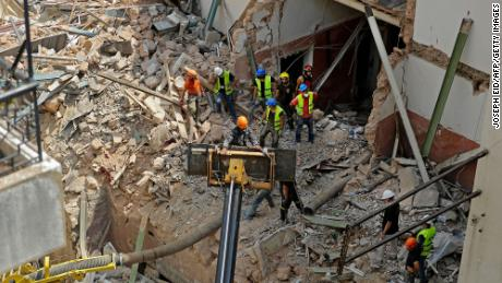 Rescue workers are digging up the rubble of a badly damaged building in the Lebanese capital, Beirut, and searching for survivors.