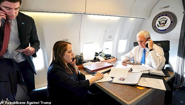 Here Olivia Troy (left) is photographed with Vice President Mike Pence (right) in the Air Force Two