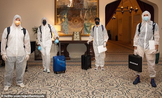 Steve Smith (from left), Tom Curran, Andrew Die and I wore Hazmat suits when they arrived