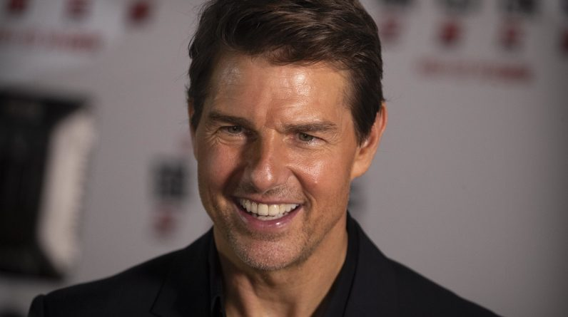 "Tom Cruise smiles as he gives an interview during a red carpet event for the movie ""Mission: Impossible - Fallout"" at the Imperial Ancestral Temple in Beijing, China, Wednesday, Aug. 29, 2018. The film opens in China on Aug. 31. (AP Photo/Mark Schiefelbein)"