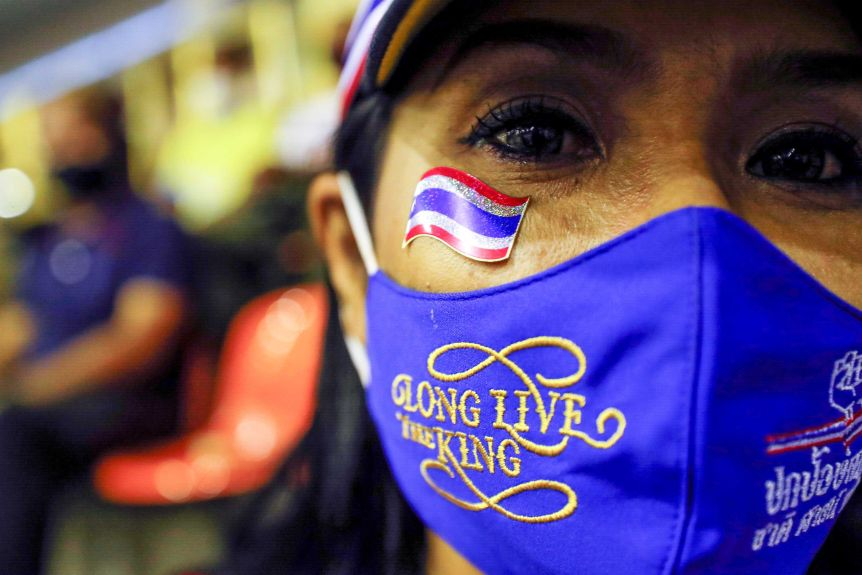 "A woman in a facemask follows: ""Long live the king"""
