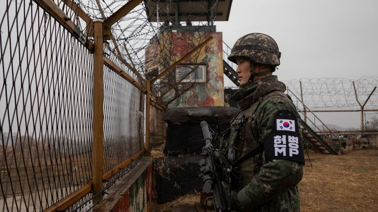 In a photo taken on December 3, 2018, a South Korean soldier stands in front of a security post inside a militarized zone (DMZ) near the Military Boundary Line (MDL) that separates North and South Korea.  Siorvan County