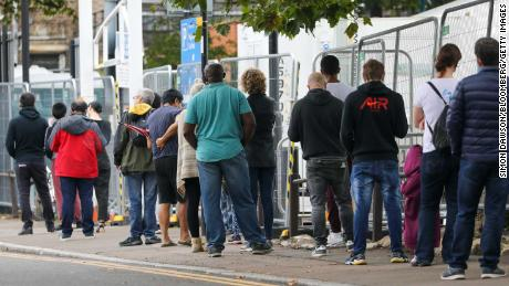 Visitors line up at a corona virus walk-in testing center in Edmonton, London on Wednesday.