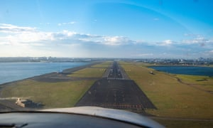 A recreational pilot prepares to land his plane at Sydney Airport on Sunday