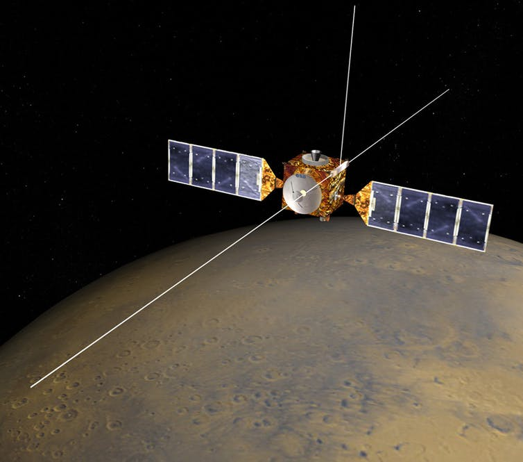 Description of the satellite with Mars in the background.