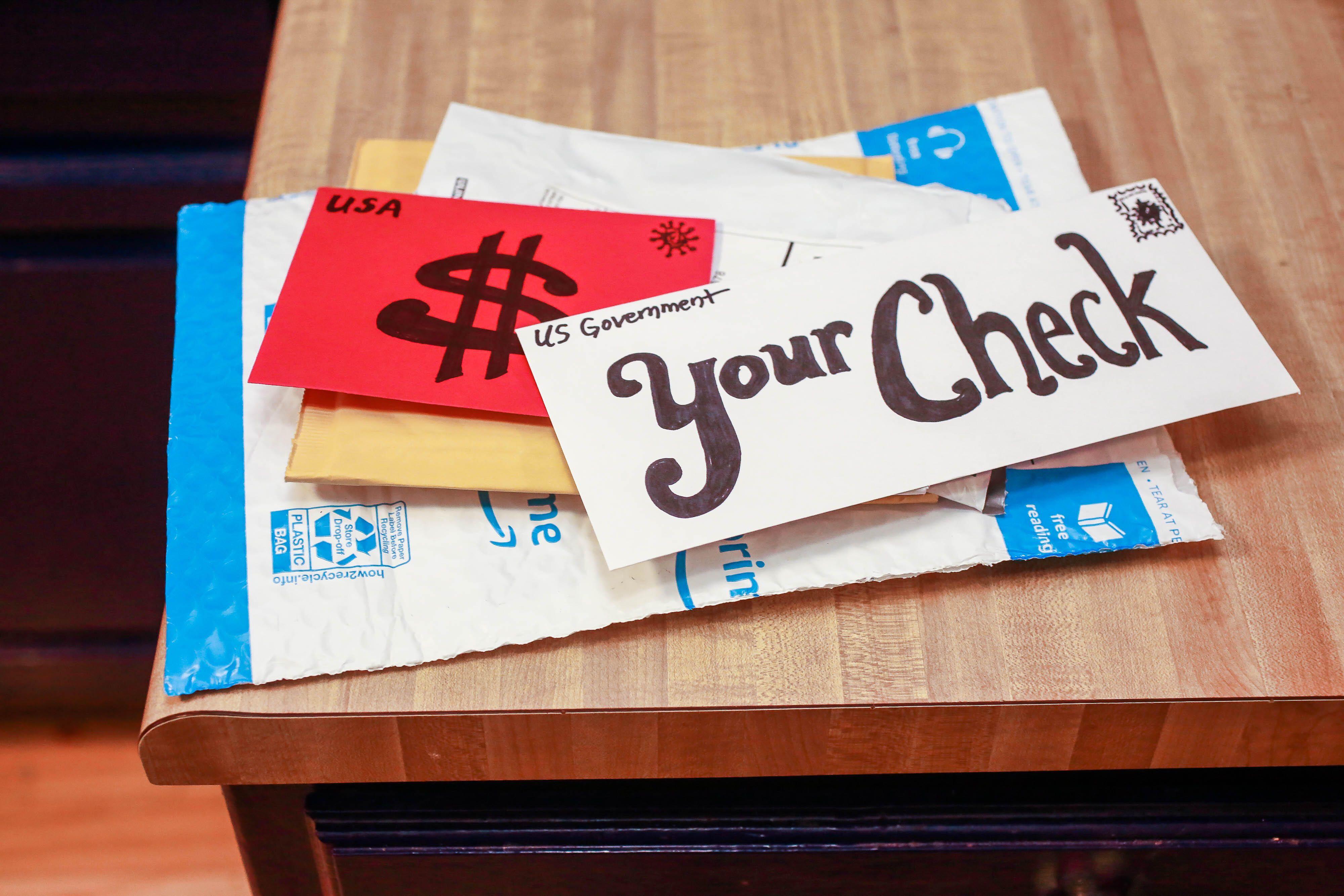 Trigger-check-us-mail-envelope-money-2020012
