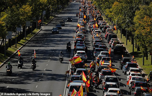 Anti-lock protesters block the road during their protest in Madrid on Monday