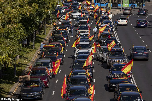 Demonstrators waving Spanish flags took place in Madrid on October 12, 2020, during the second wave of the Covit-19 epidemic on Castellana Street on Spain's National Day.