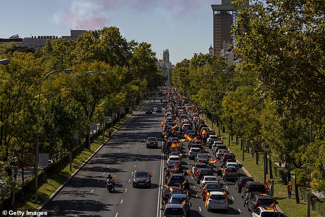 Protesters wave Spanish flags on Spanish National Day on October 12 during the second wave of the Covit-19 epidemic.